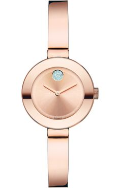 Movado Bold - Mid-size Movado BOLD watch, 34 mm rose gold ion-plated stainless steel case, rose gold-toned sunray dial with clear crystal-set dot and rose gold-toned hands, rose gold ion-plated stainless steel bangle bracelet with back sizing links and deployment clasp, K1 crystal with rose gold-toned metallization, Swiss quartz movement, water resistant to 30 meters, MADE WITH SWAROVSKI ELEMENTS.