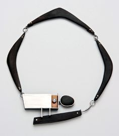"Laurie Hall: 1950 ""Boomerang""   Necklace in sterling silver, ebony, beach pebble, pearl, bakelite, and oxidized silver."