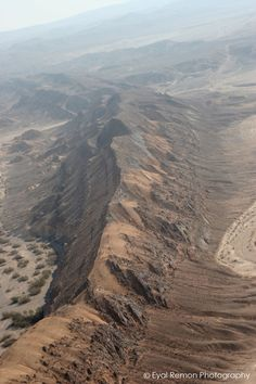 Tzihor Ridge, Israel. Wadi Tzihor, just south from Har Ha'Negev, between Wadi Paran and Wadi Sira. Situated in the 'Shumrot Nahalim Ha'Gdolim (Large Nahal Reserve). Photo taken at roughly 800 feet from a light aircraft in the early morning, hence the hazy horizon.
