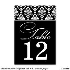 "Table Number Card | Black and White Damask Design Each table number card must be customized via Personalize it"" and individually added to the shopping cart. An elegant black and white damask pattern and formal script are featured on these custom two-sided table number cards."