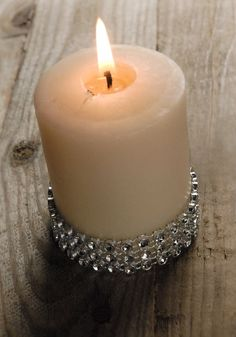 Cheap alternative to candle holders, wrap ribbon mesh around candles for a elegant look.
