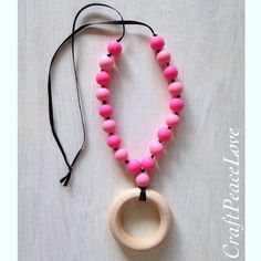 Hot Pink and Light Pink Teething Necklace/Nursing Necklace with Silicone Beads and Wood Teething Ring - pinned by pin4etsy.com