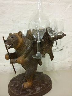 A Black Forest carved bear liqueur decanter and 6 matching glasses tantalus Sold £90 BourneEndAuctionRooms