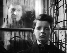 The Innocents (1961). Martin Stephens as the boy Miles and Peter Wyngarde as the ghost of Peter Quint.
