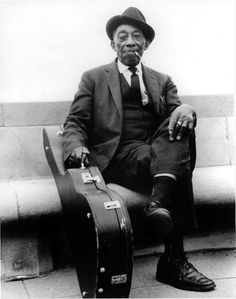 Mississippi John Hurt - taught me to fingerpick, long after he died.  A great blues legend and pioneer of folky blues.  His music makes me happy.