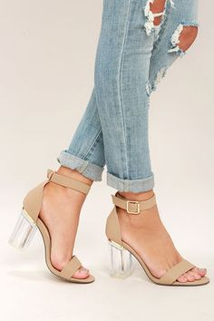 We bet you're going to really, really want the Odette Nude Lucite Heels! Matte vegan leather forms a slender toe strap, and matching ankle strap that secures around the ankle with a gold buckle. Lucite block heel accent with shiny gold trim adds a luxe touch!