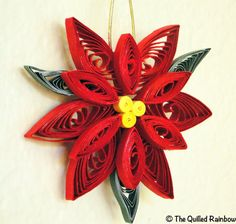 I have some quilling tools.  Not sure how long it would take to make enough for Sarah's ornament exchange.   The Original Quilled Poinsettia Flower - Handmade Christmas Ornament