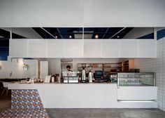 """Swimming Pool Studio aimed to bring the """"relaxing and refreshing"""" hues of blue sea and white sand to this cafe inside a Shanghai office building."""