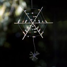 Beaded Spiderweb  http://spoonful.com/halloween/best-bat-spider-decorations-halloween-gallery?cmp=SMC|spoon||FB|BeadedSpiderweb|InHouse|101212|Craft|KN|famM|#carousel-id=photo-carousel=5