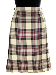 """Purple, charcoal and ivory make up the plaid in this lovely skirt, made in Scotland. Wraps with leather """"belt"""", unlined, flat front, pleated back. Pitlochry label. Marked Size: 16 - Waist: 29""""-31"""" (ma"""