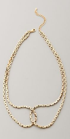 Looks like a peter pan collar and may be easy to make from old chains.