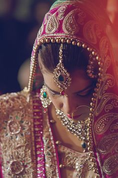 The colorful dress and matching accessories.  An average traditional Indian Bridal wear weighs around 8-10 Kgs in total.