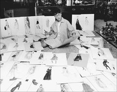 Edith Head surrounded by some of her fashion designs