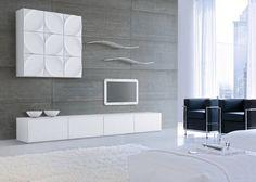 Une alliance entre fonctionnalité et design pour un coin salon ordonné, épuré , accompagné d'une touche unique d'élégance et d'originalité. Ce super ensemble mural brillant est composé d'un banc TV, de 2 étagères murales et 1 élément mural. Bientôt disponible !