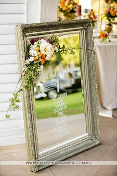 Mirror with signage and floral detail. Styled shoot by Lovebird Weddings.