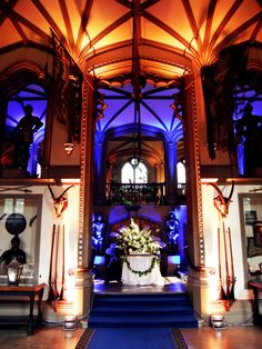 Belvoir Castle Leicestershire - Wall uplighters in blue and amber plus gobo projection in white by www.stressfreehire.com #venuetransformers