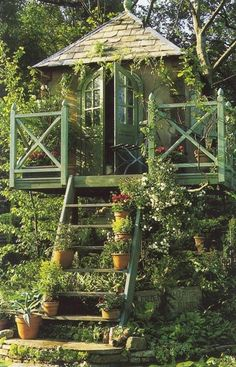 Whimsical Raindrop Tree House Cottage and garden area too!  Nice!