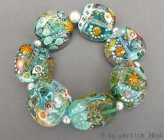 """Bracelet stretch handmade with seven free shaped flat lampwork glass beads and silver beads  """"Treasure of the mermaid""""   by FrauPerlich"""