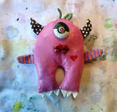 Pink One Eye Monster Wall Doll by jodieflowers on Etsy https://www.etsy.com/listing/121080667/pink-one-eye-monster-wall-doll