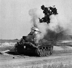 The ammunition exploding in a burning Panzer III. Russia, 1941.