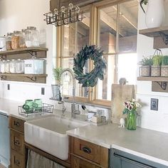 I Spy Antique Farmhouse products in Lucy Rose's stunning #farmhouse #kitchen! #homedecor