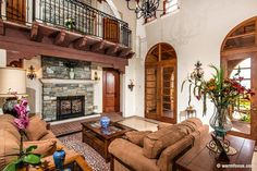 Mediterranean-Living-Room-with-French-Doors-and-Stone-Fireplace