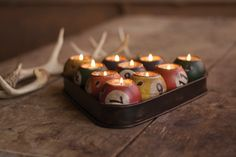 """From family game room to chic bachelor pad, this cheeky accessory is sure to have people grinning. It holds ten tealights (not included) to create a warm glow in the darkest of man caves :) 12"""" x 3""""t"""
