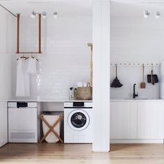 A length of peg rail corrals a few cleaning essentials in the laundry room. See Steal This Look: All-White Laundry Room in Melbourne. White Laundry Rooms, Laundry In Bathroom, Laundry Bin, Laundry Rack, Small Laundry, Laundry Basket, Small Bathroom, Küchen Design, House Design