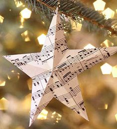 Sheet Music Ornaments Add a musical note to your Christmas tree with these quick-to-craft paper ornaments. All you need is some sheet music, some thread, and our helpful pattern Sheet Music Ornaments, Music Christmas Ornaments, Sheet Music Crafts, Christmas Sheet Music, Paper Ornaments, Christmas Decorations, Easy Ornaments, Paper Decorations, Navidad Simple