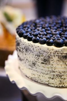 lemon poppy seed cake with meyer lemon icing and fresh blueberries