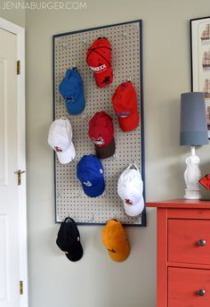 Diy art the man cave pinterest game rooms game room decor diy pegboard baseball cap organizer the perfect home for the hat collection solutioingenieria Gallery