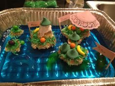 Kids Edible landform project. Very easy! Blue jello for ocean, rice krispie treats for island with peanut butter for sand/glue and coconut flakes with green food coloring for grass/vegetation. Gummy sharks for fish in the ocean. Bananas, oranges hard candies for plants. Medium Minty non-pariels for trees. Betty Crocker white fluffy frosting for snow on mountain. Bamboo skewers, craft glue and doily for umbrella. Skewers, craft glue/tape for flags.