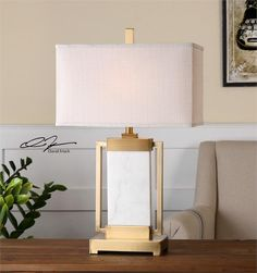 Marnett Item #26940-1 ...129...Brushed brass plated metal displaying a thick slab of white marble. The rectangle hardback shade is a coarse weave beige linen fabric.  Designer:David Frisch Wattage/Bulb Type:100W, ON-OFF # of Bulbs:1 Dimensions:28H,   Shade 17W X 9D (in) Weight (lbs):15 Ship Via UPS:Yes UPC Number:792977269404