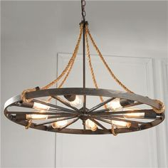 Make your own wagon wheel chandelier weddings pinterest wagon vintage wagon wheel chandelier aloadofball Image collections
