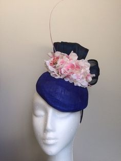 A personal favourite from my Etsy shop https://www.etsy.com/au/listing/512819929/gorgeous-blue-fascinator-with-silk-abaca