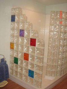 Colored glass block could add some color and decoration to the glass black walls.
