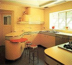 Art Deco kitchen, with both the 'streamlined' look of the base units, stepped shapes of the wall units, colours & materials