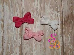 Infant hair bows. These are Velcro and a must have for newborn girls. Made by Shana's Boutique www.Facebook.com/shanaboutique