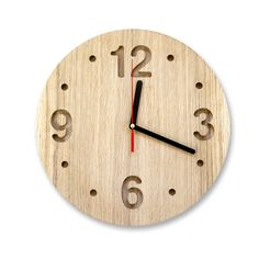 Wall clock made out of solid oak, ash or maple, minimalistic style. €90.00, via Etsy.