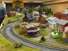 Build a village around a model train layout... heck yes!
