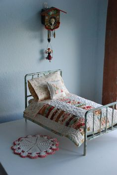 Cute mini doll bed with quilt, tiny pillow, cuckoo clock, crochet rug