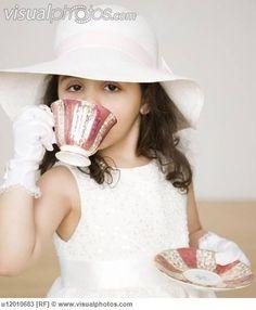 Girls Play Tea Party Hats   Hispanic girl dressed up at tea party [u12010683] > Stock Photos ...