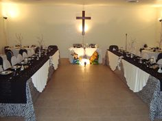 Bride and Groom's table underneath the cross.  Wedding Party on each side.  Creating a dance area in the middle.