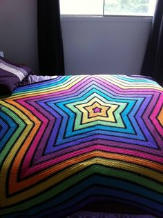Rainbow Star Blanket! (photo on imgur, notes on reddit, and more info here:  http://thekidneybean.wordpress.com/2007/11/12/bullseye/ )