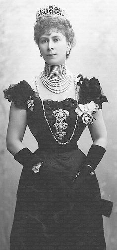 Queen Mary in an incredible amount of pearl and diamond jewelry.  Before cultured pearls were grown, pearls were more valuable than diamonds.