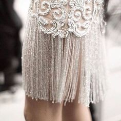 • INSPO • In love with this gowns intricate beading work and those fringe details! •