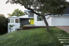 This Austin house with views of Hill Country combines a diverse selection of wood with curving white walls and plenty of natural light.  After their three kids had grown up and moved out, a retired couple decided that they were finally going to get the property they had always wanted.