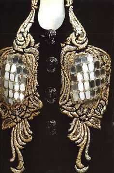 """Baroque Mirror Jacket  From """"Elsa Schiaparelli"""" by Francois Baudot    """"Sumptuous jacket in black velvet designed in 1939, with two embroidered gold and silver motifs in the shape of baroque mirrors. (Metropolitan Museum of Art)"""