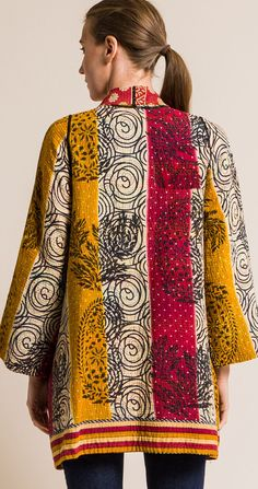 $760.00 | Mieko Mintz 4-Layer Vintage Cotton A-Line Jacket in Crimson/Marigold | Mieko Mintz creates clothing from vintage saris, which are upcycled into new fashion. The reversible clothing is an artful multi-pattern combination of by Mieko that is then made into kantha fabric. Sold online and in-store at Santa Fe Dry Goods in Santa Fe, New Mexico. Quilted Clothes, Sewing Clothes, Made Clothing, Patchwork Designs, Dry Goods, Jacket Pattern, Kimono Fashion, Vintage Cotton, Santa Fe