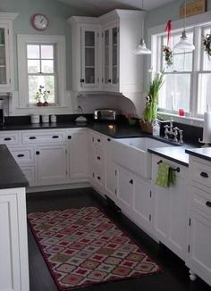 Love the sink! Great use of small kitchen space with this apron farmhouse sink and honed black granite countertops.  **********************************************  I like the scrollwork under the kitchen cabinets.  Would love to do this!!